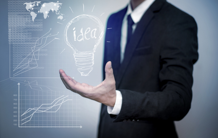 entrepreneur holding an idea lightbulb with graphs