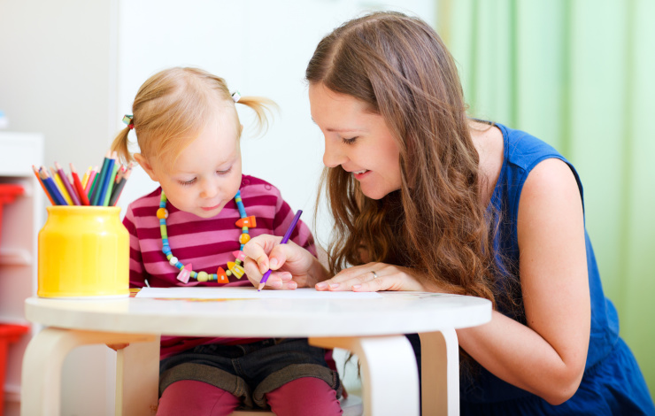 nanny coloring with young child