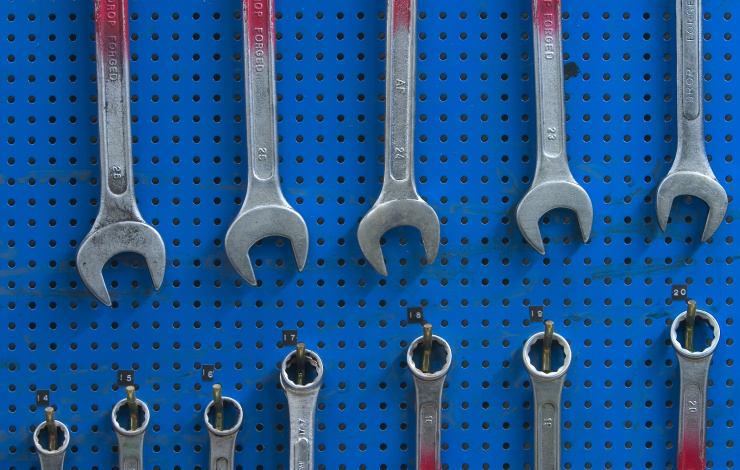 wrenches lined up on blue background
