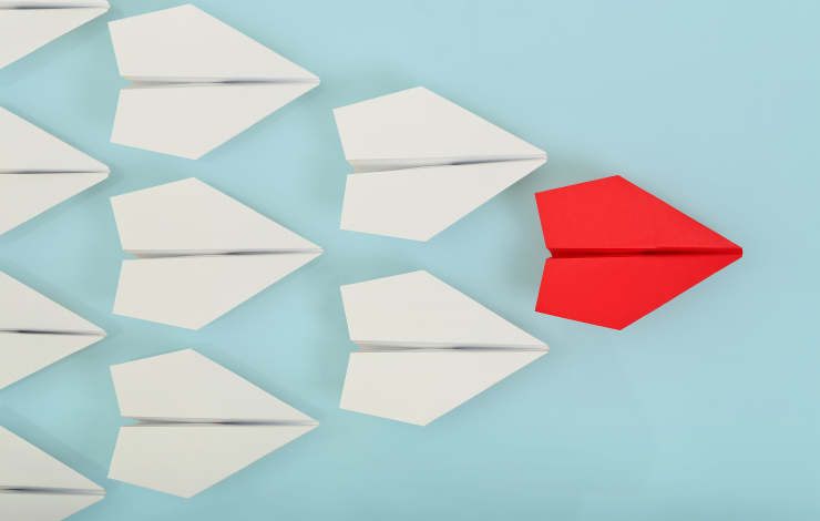 paper planes on blue background with one red plane