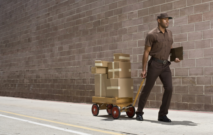 delivery man in brown UPS uniform