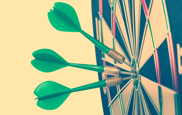 green darts on a bullseye