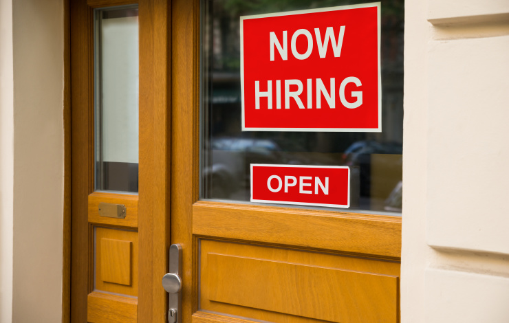 The Text Now Hiring Sticker Attached On Glass Door Of The Office