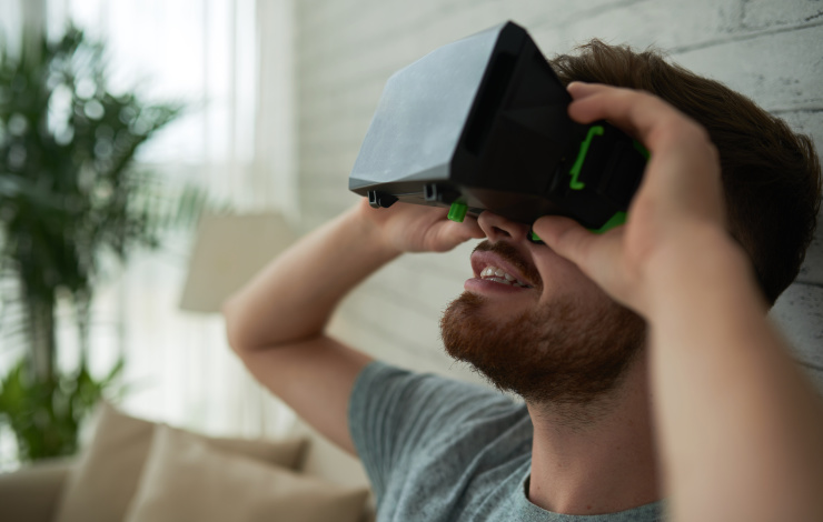 Head of young man wearing virtual reality device