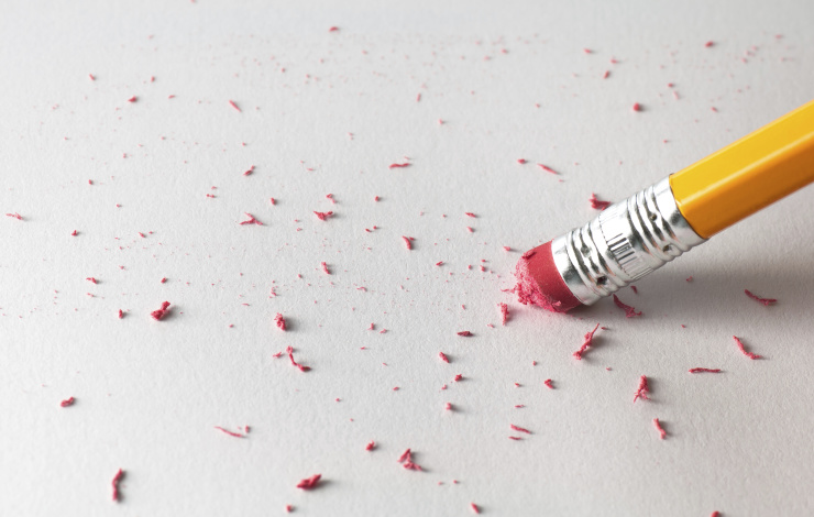 erasing a mistake with a pencil eraser
