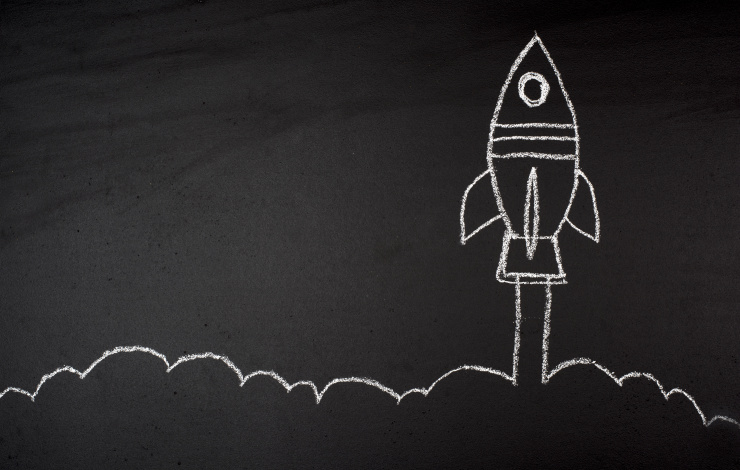 rocket ship drawn on a chalkboard