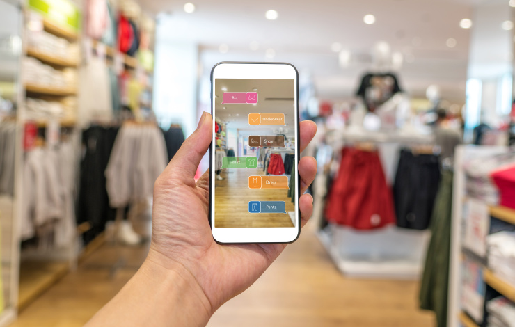 cell phone with augmented reality image in clothing shop