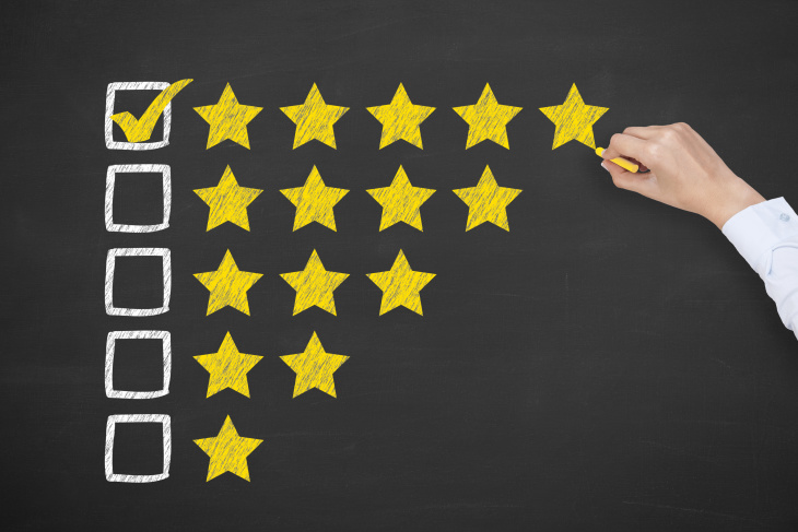 person selecting five stars for customer service