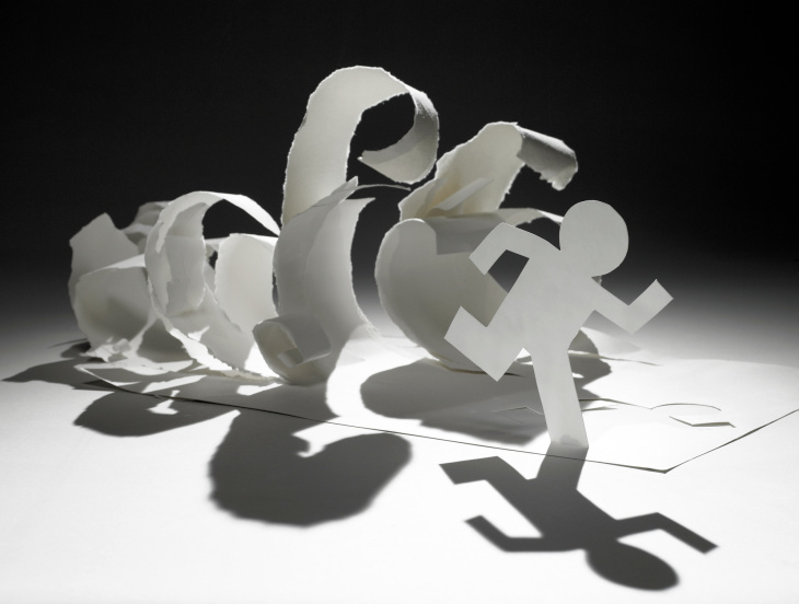 paper man cut out​ running away from paper waves