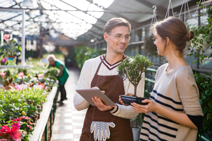 woman buying plants at a nursurey