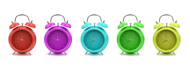 Colorful alarm clocks isolated on white background