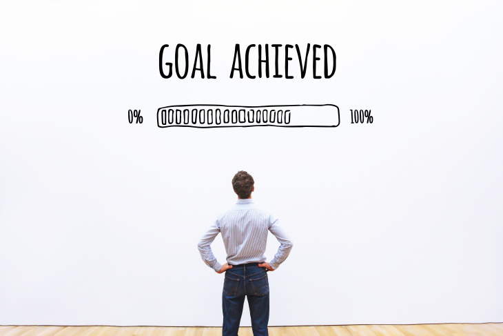 Man in front of goal progress bar