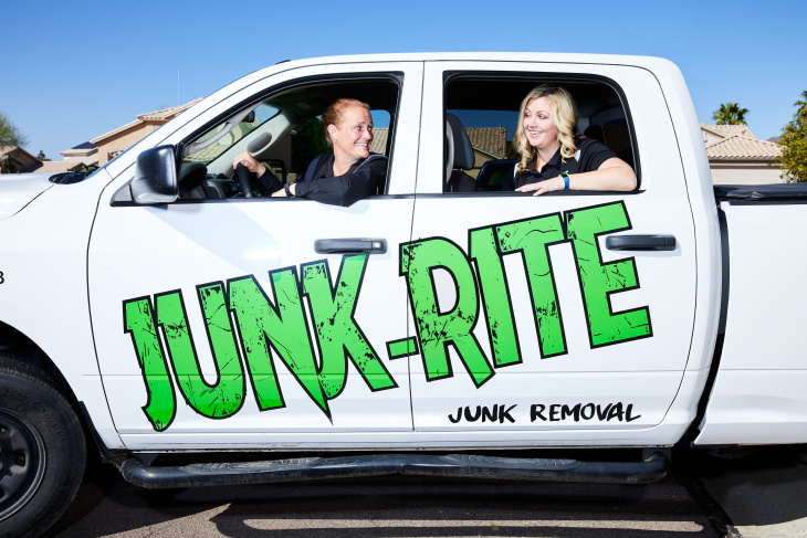 Junk-Rite co-owners in their truck