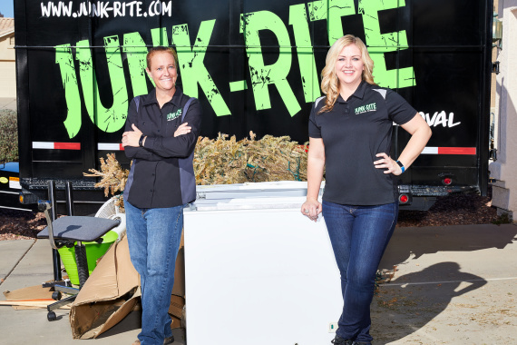 Junk-Rite owners showing off one of their branded box trucks.