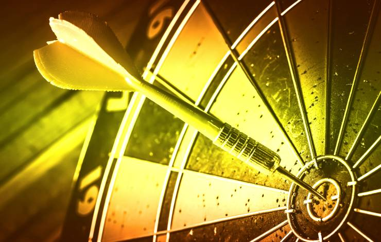 Target marketing or target arrow concept: Bullseye is a target of business. Dart is an opportunity and Dartboard is the target and goal.