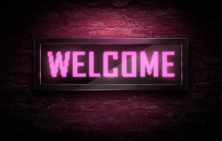 Welcome Led signage on brick wall
