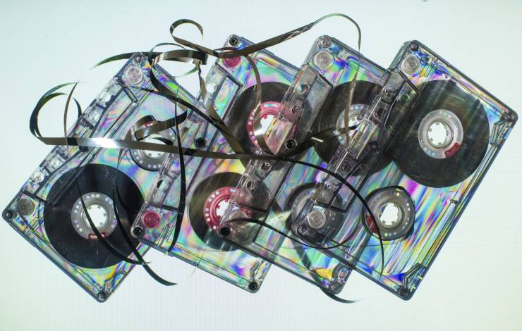 cassette tapes with ribbon unfurled.