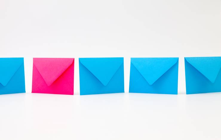 Different blue and pink  envelopes on the white table