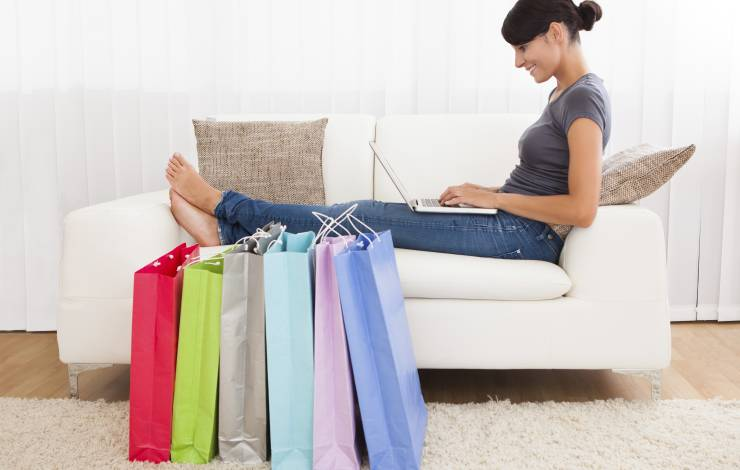 woman shopping online with bags
