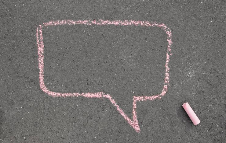 speech bubble on sidewalk made out of pink chalk