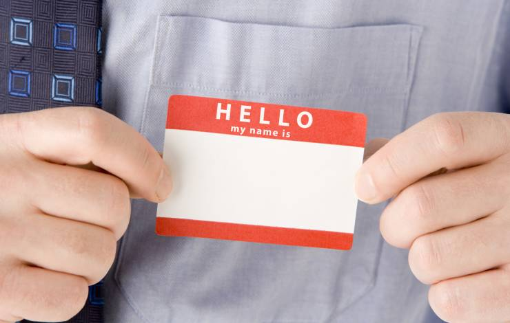 a new employee putting a name tag sticker on