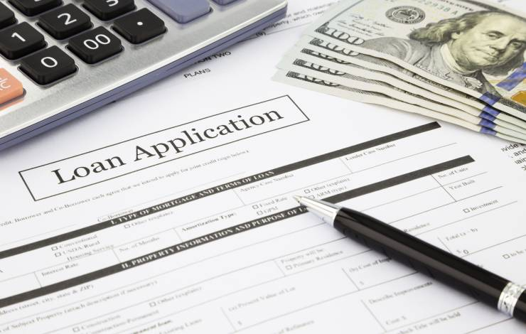 loan application with calculator and money