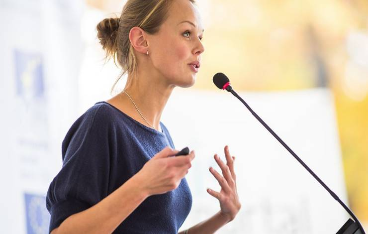 A woman speaking at a conference.