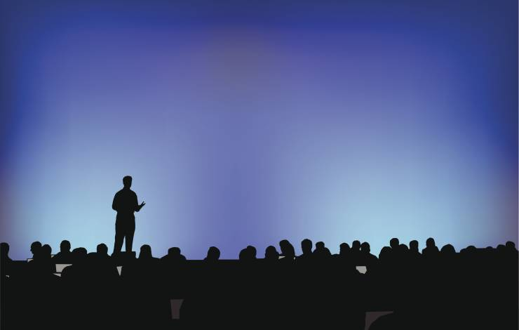 crowd listening to a speaker at a conference