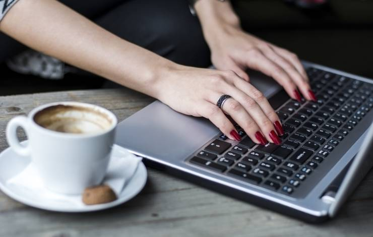 woman blogging with a cup of coffee