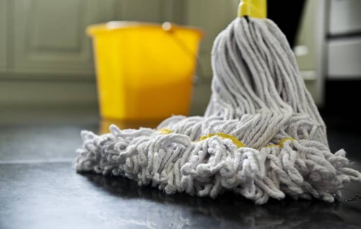 mop on kitchen floor with bucket