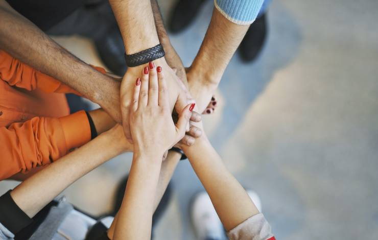 hands in a circle showing team involvement