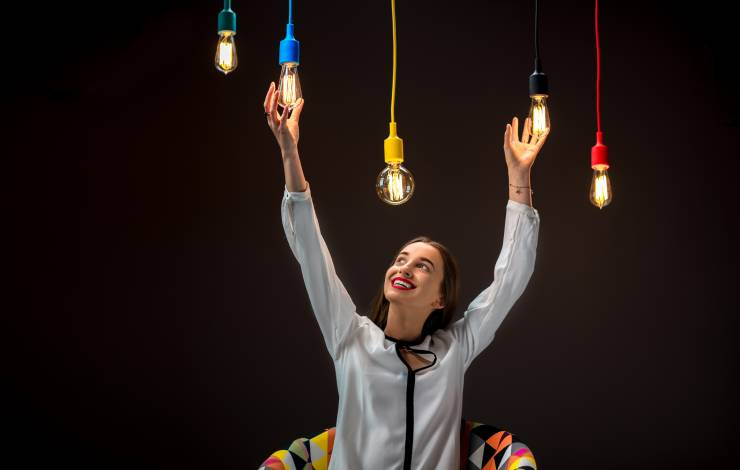 woman changing light bulbs on colorful cords