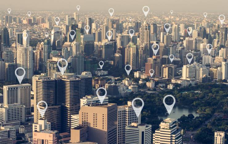 Map pin flat above city scape,technology concept