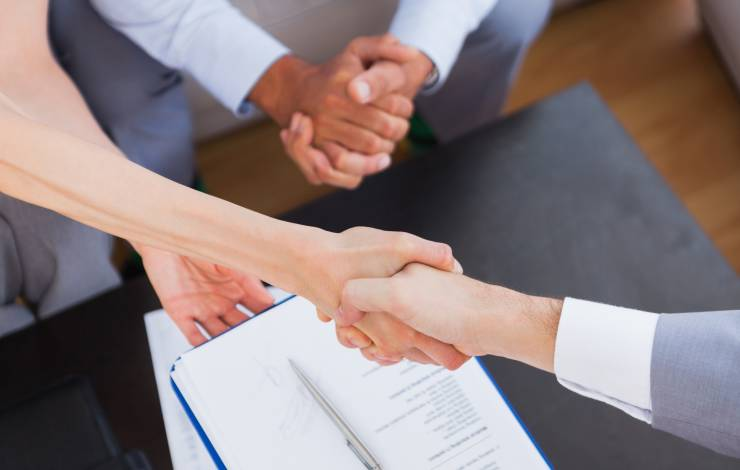 shaking hands over a business agreement