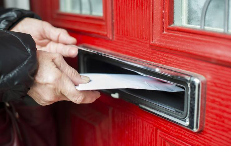 putting a letter in a mail slot