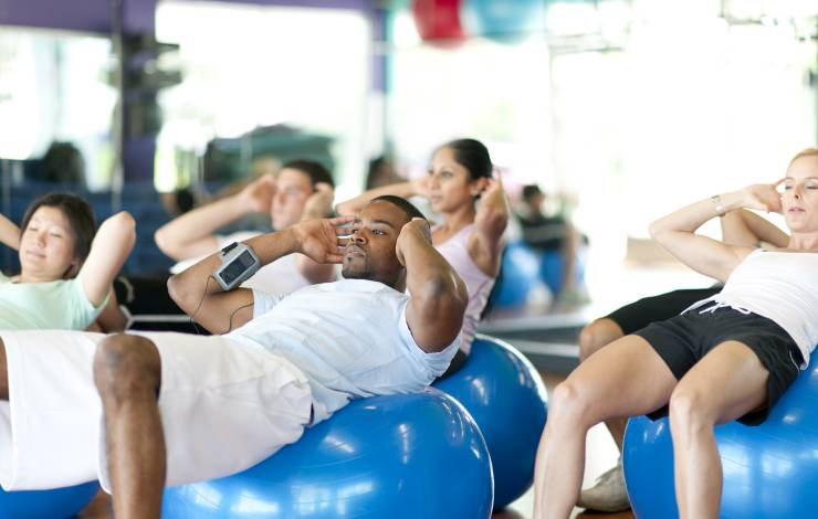 people in a workout class using exercise balls
