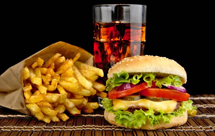cheeseburger with fries and a drink