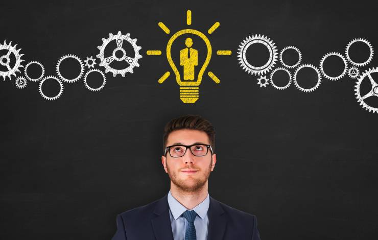 HR man standing below a lightbulb with a person in it