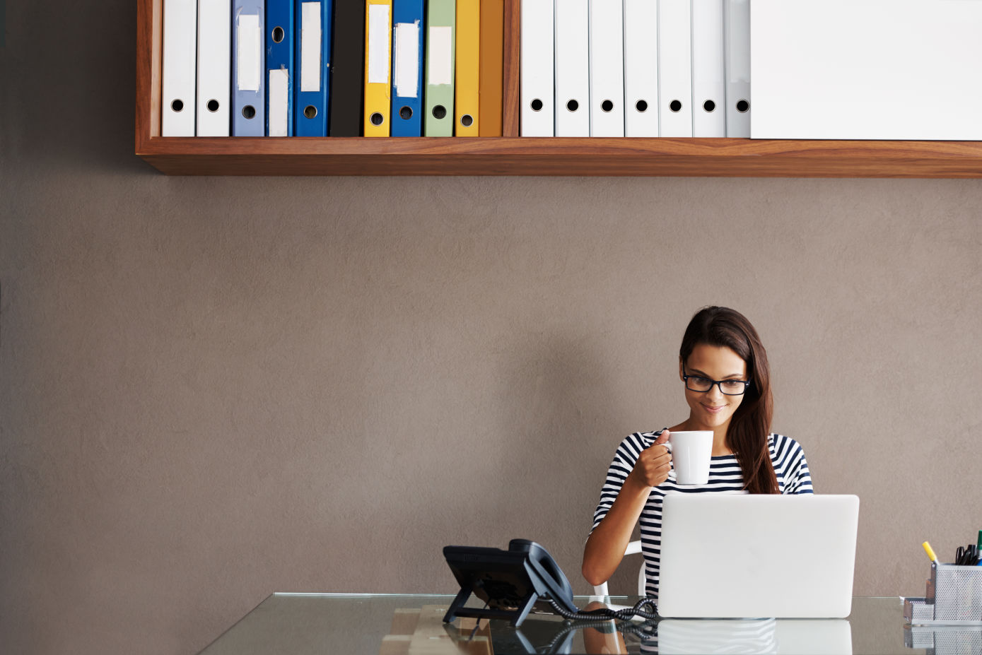 small business owner sitting at desk