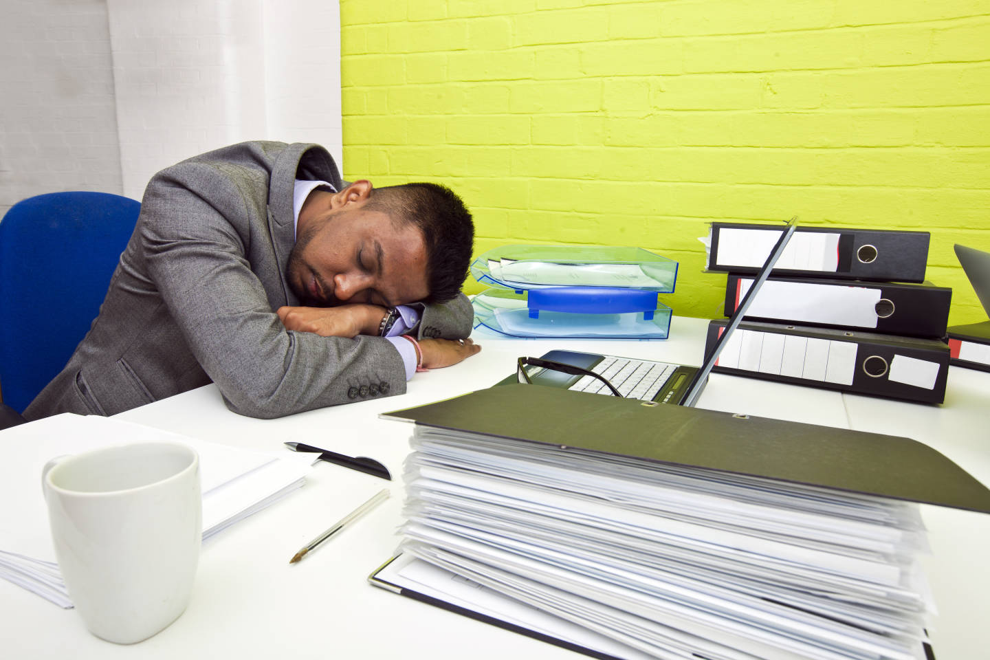 Indian businessman asleep at his desk