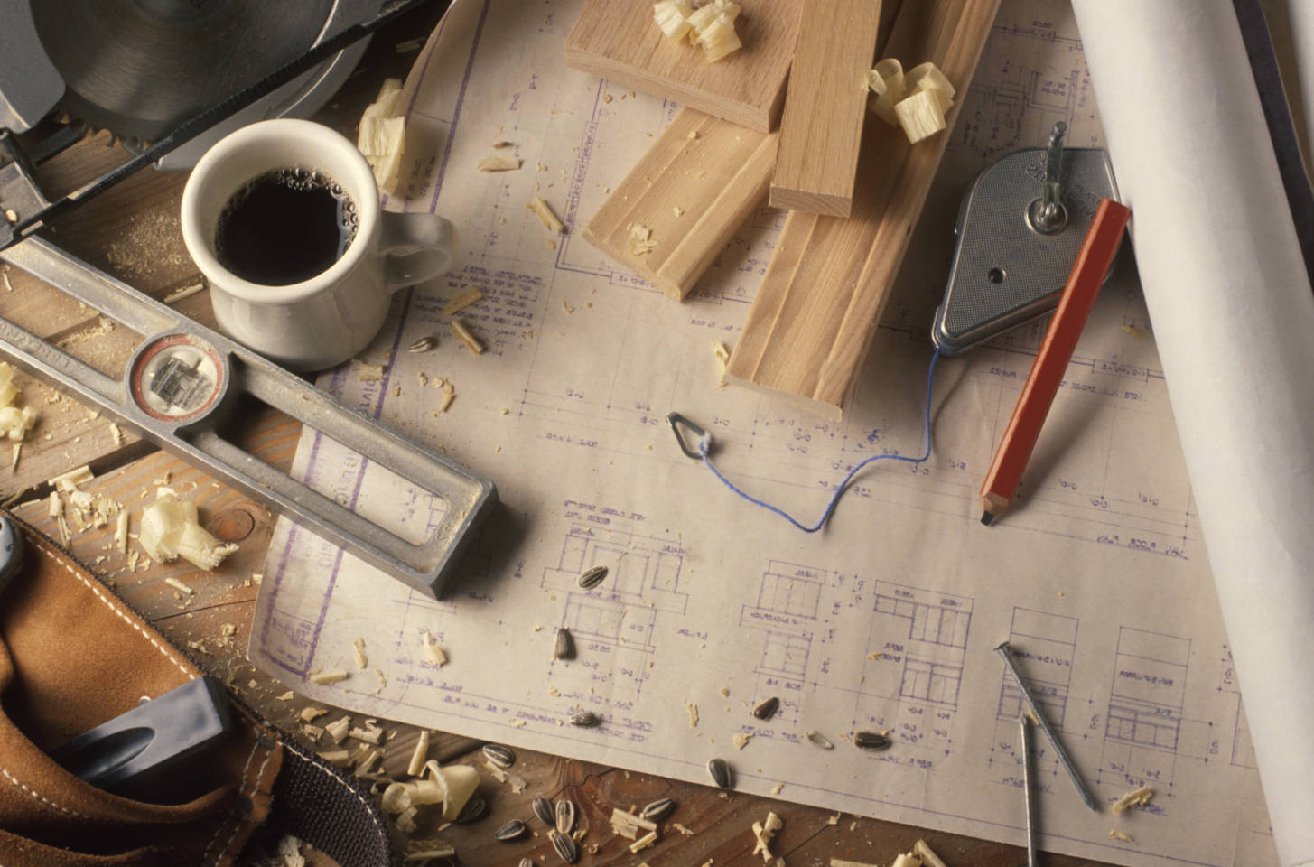 building supplies with wood and blueprints