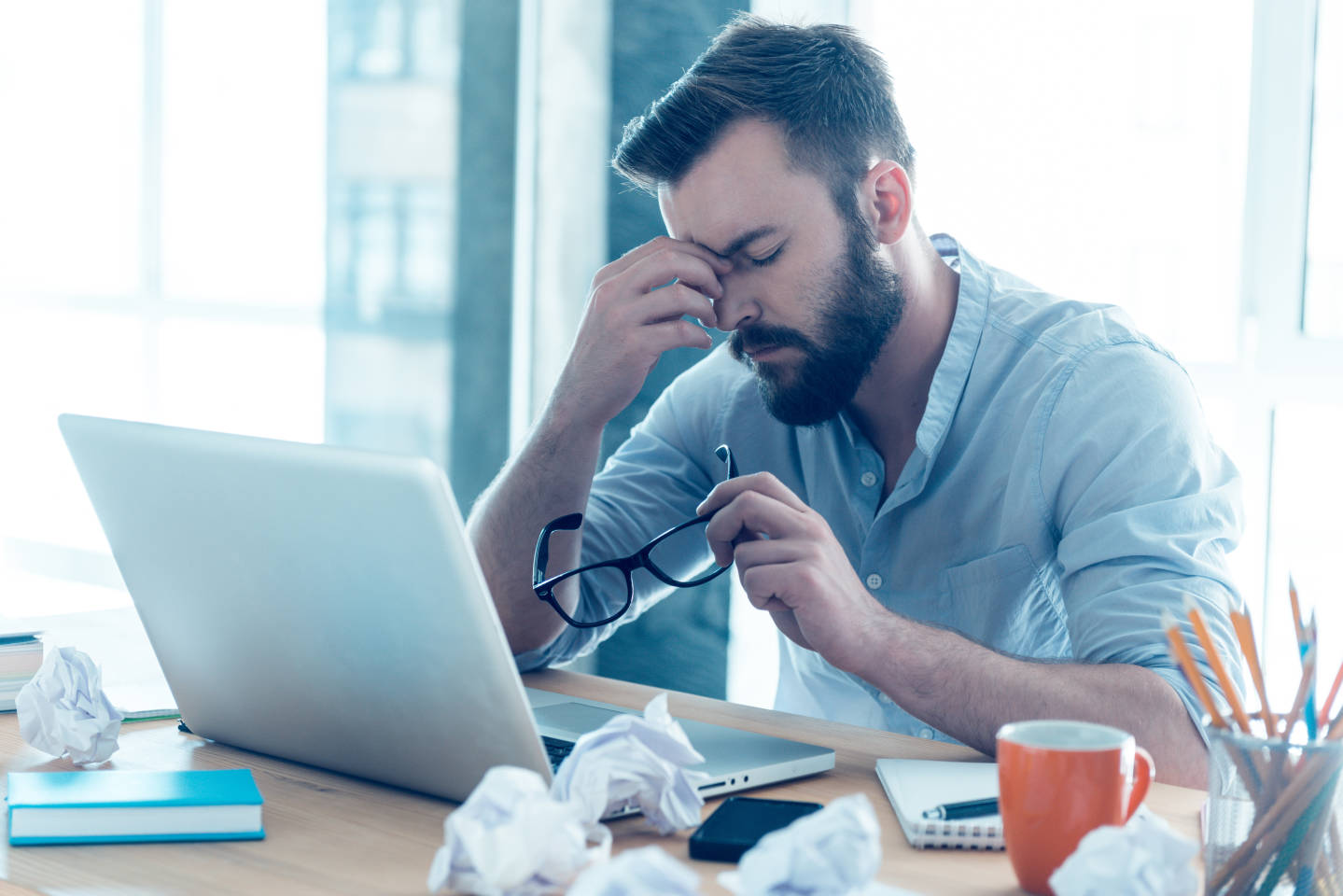 man sitting at computer stressed out