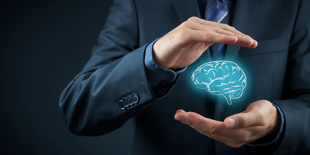 A man holding an illustrated brain to represent ideas and insights.