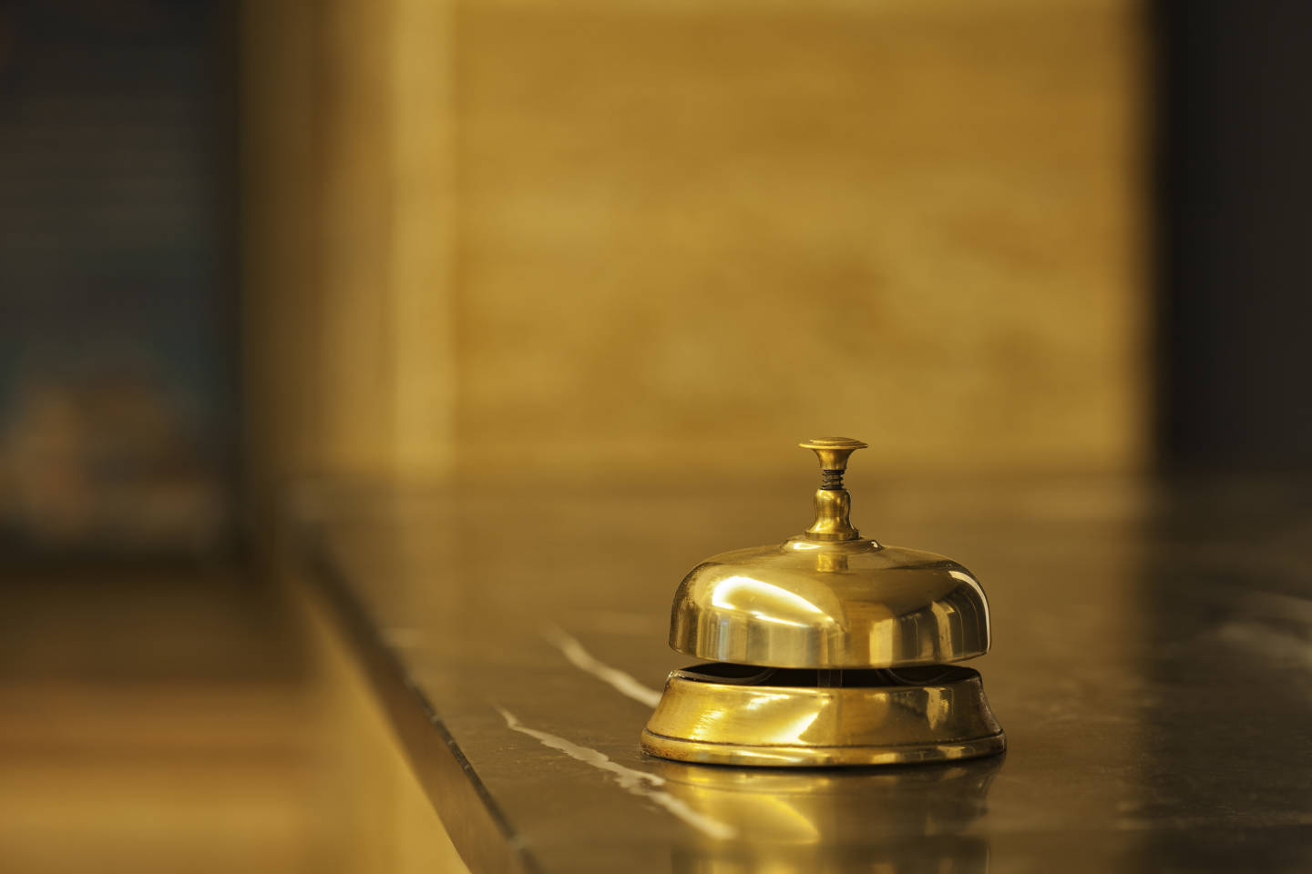 gold bell in hotel lobby