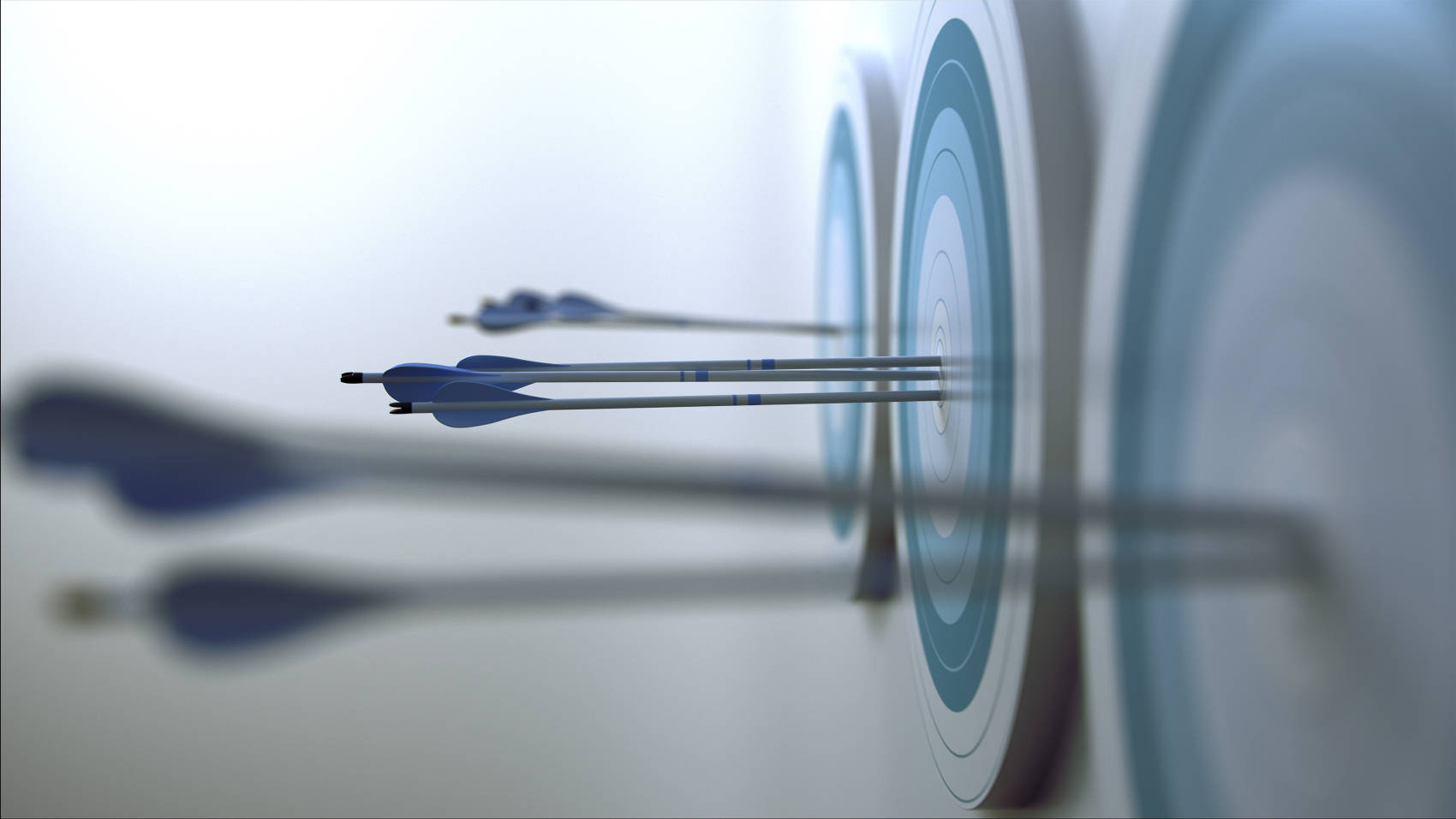 arrows on the bullseye of a blue target