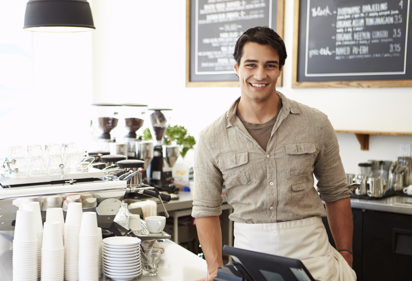 coffee shop owner representing welcoming customers