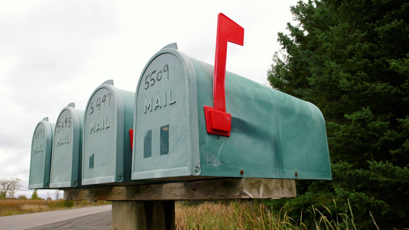 green mailboxes waiting for mail delivery
