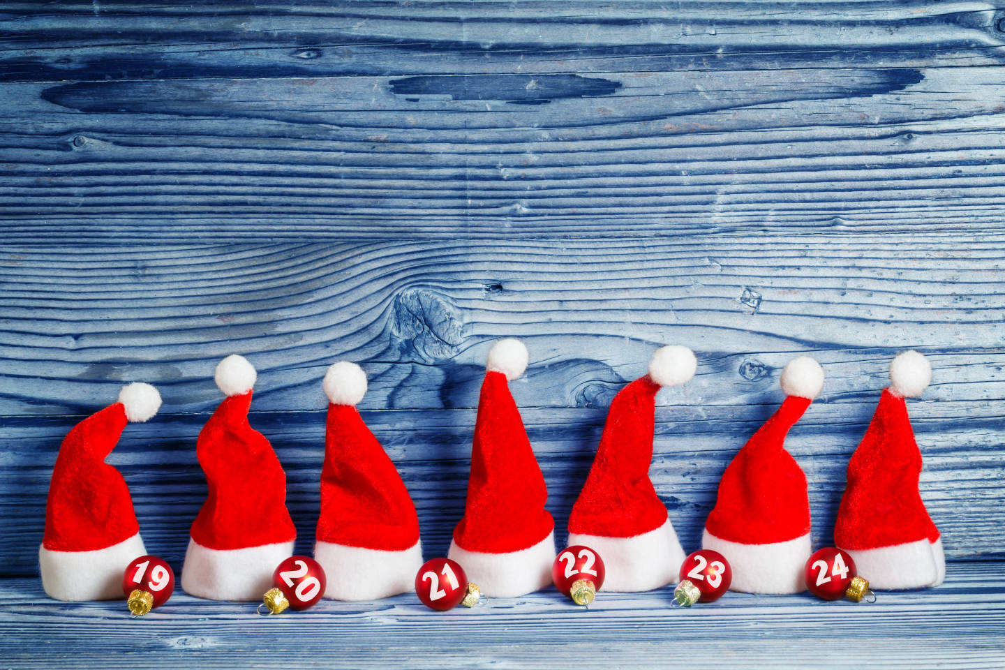 row of santa hats with christmas balls showing number of days until christmas