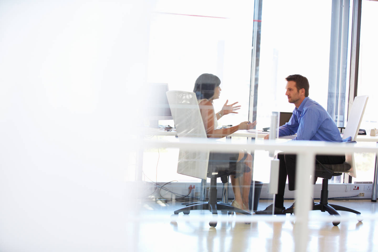 two colleagues meeting in an office