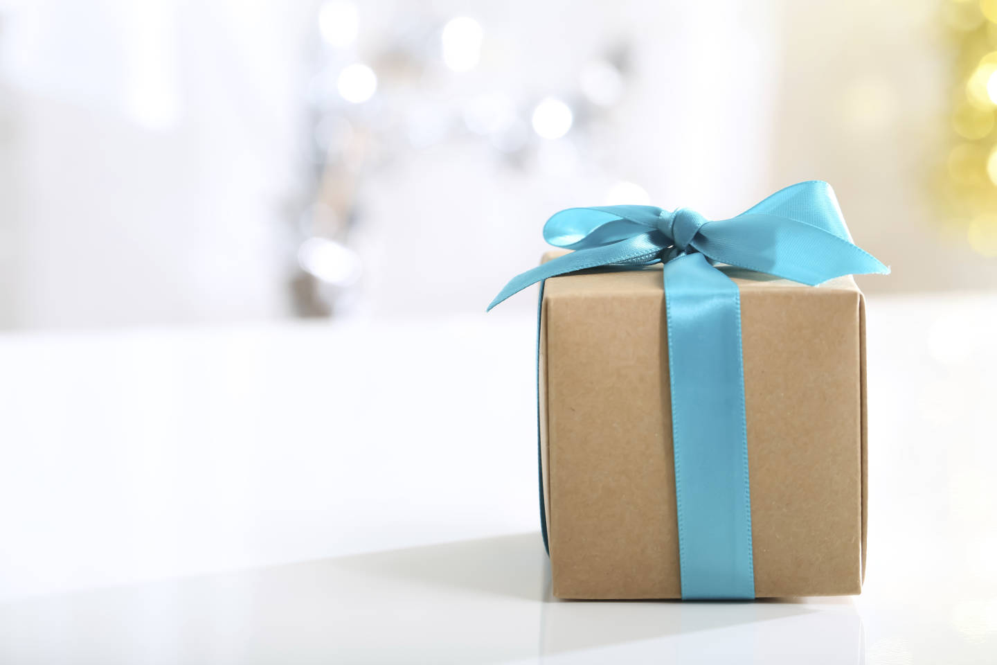 brown gift box with blue bow